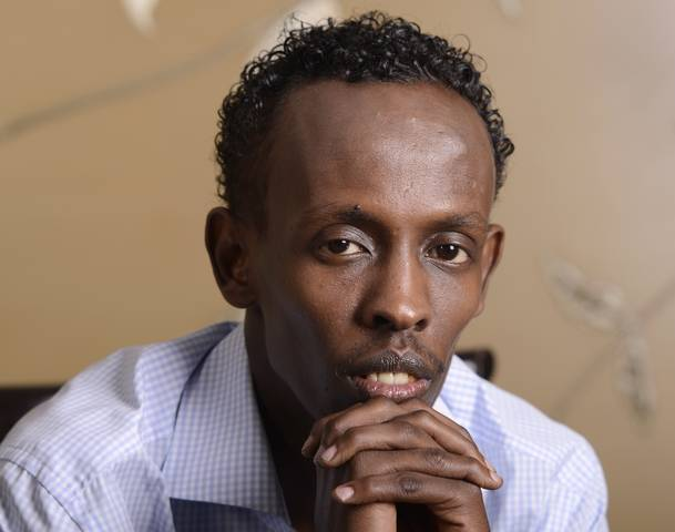 "Actor Barkhad Abdi poses for a portrait during a photo opportunity for the film ""Captain Phillips"" in Los Angeles"